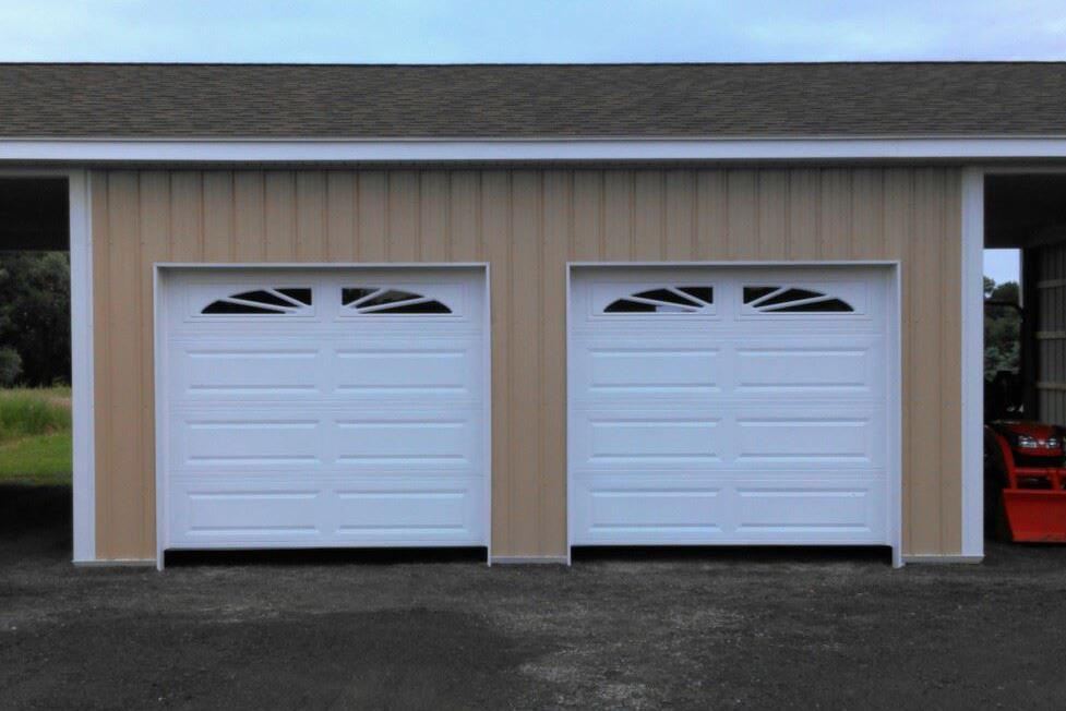 8x7 CHI Overhead Doors W Sunburst Decorative Inserts Gasport NY