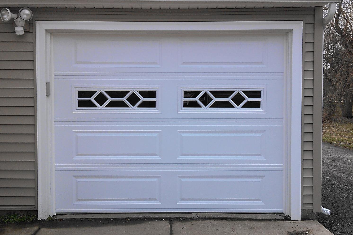 9x7 Overhead Garage Door w-Waterton Decorative Inserts